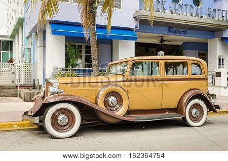 Vintage Car Parked On Ocean Drive In Miami
