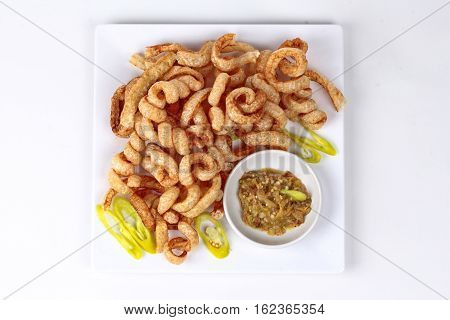 Crispy Pork Rind  Served With Green Chili Dip .