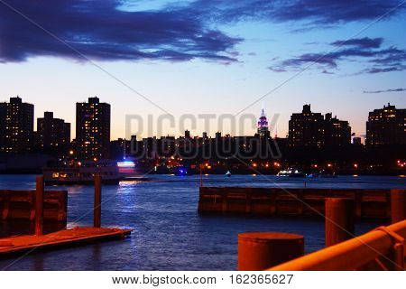 the sun sets on new york city and the east river
