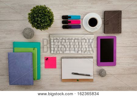Colorfully business desktop objects on a grey wooden background