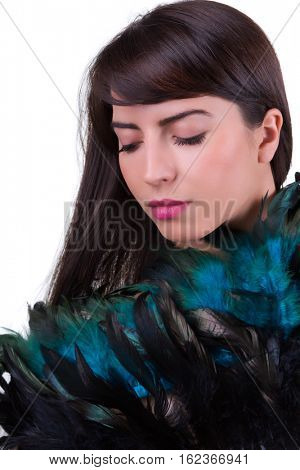 Iridescent feather fan held by a beautiful woman