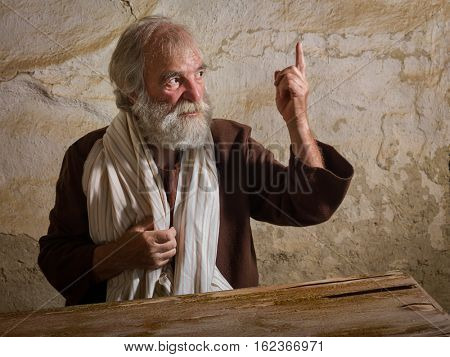 Prophet in historical reenactment bible scene making a prophecy