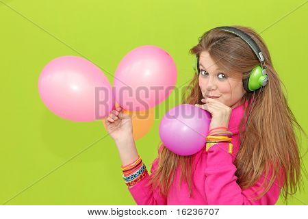 casual earphones fashion fun girl green happy headset jeans mp4 music person personal player singing smiling teen teenager trendy wall young youth