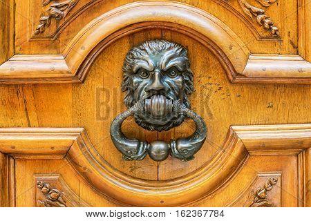old doorknocker at a wooden door in Aix-en-Provence France