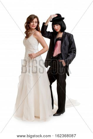 Role-playing games. Full length of  female gay couple dressed like groom and bride standing in studio, isolated on white