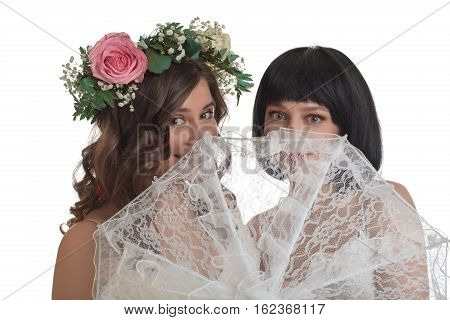 Wedding concept. Portrait of two beautiful young women with lace umbrella posing to camera on white isolated background, studio shoot