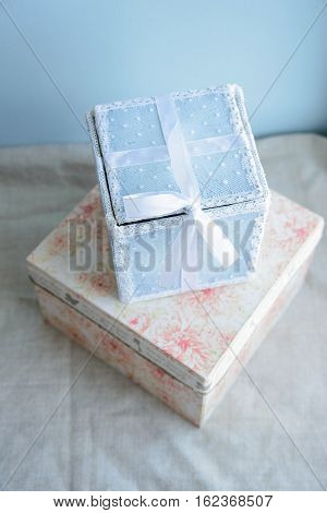 festive gift box with lace and satin ribbon on the birth of baby boy