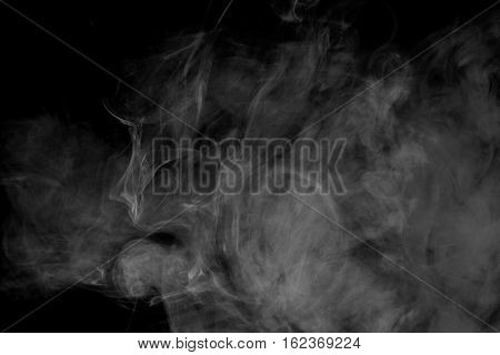 Abstract smoke Weipa. Personal vaporizers fragrant steam. The concept of alternative non-nicotine smoking. White smoke on a black background. E-cigarette. Evaporator. Taking Close-up. Vaping.