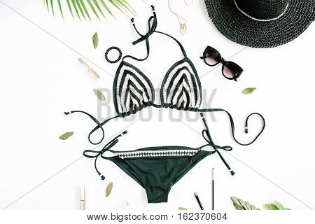 female summer bikini swimsuit accessories collage on white with hat green branches necklace and sunglasses. flat lay top view
