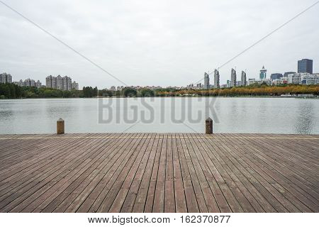wooden walkway at lakeside in the park