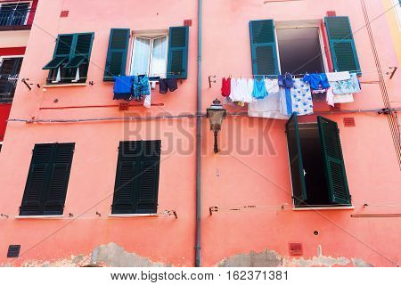 Colorful Building With Laundry In Vernazza, Italy