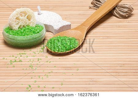 Sea salt, loofah, pumice on wooden background with copy space. Natural products and accessories for peeling and exfoliation