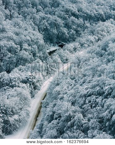 winter landscape mountain road in forest top view tinted photowinter landscape with a road in the forest top view tinted photo