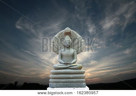 Beautiful Stone Buddha Image Covered With Seven Heads ,evening Sky.