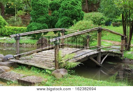 Element of landscape design the wooden bridge across the stream