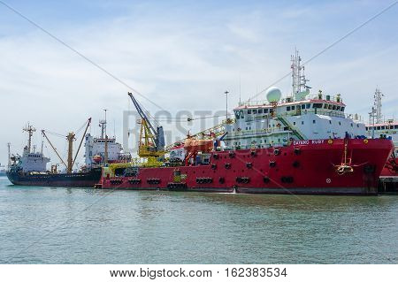 Labuan,Malaysia-Feb 3,2016:Offshore oil & gas sea construction & support vessel at port of Labuan,Malaysia.The island strategically located in the ASEAN offshore oil exploration & production region