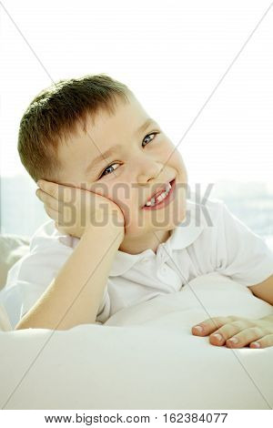 Portrait of a little boy looking at camera and smiling