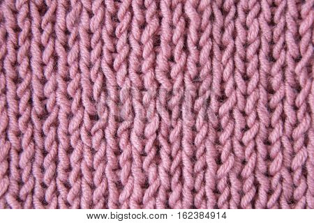 Pink knitted wool fabric close up, macro, background chunky knit