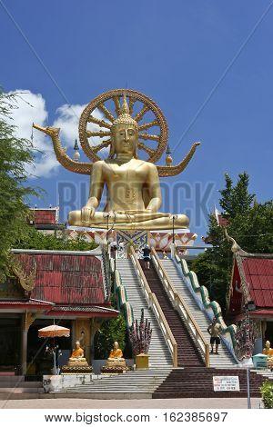 Ko Samui Thailand - July 2 2009: Steps leading up smallhill to the 12 metre seated buddha in the Wat Phra Yai Big Buddha Temple on a small island near bo phut.