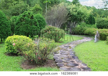 Element of landscape design a stone path in the empty park