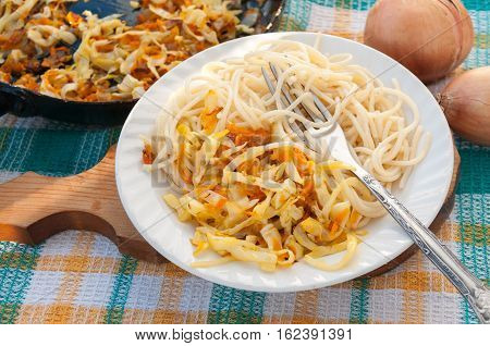 Breakfast a noodles with sauerkraut and onions