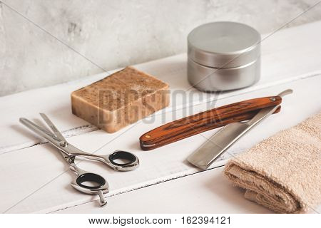 Mens hairdressing wooden desktop with tools close up