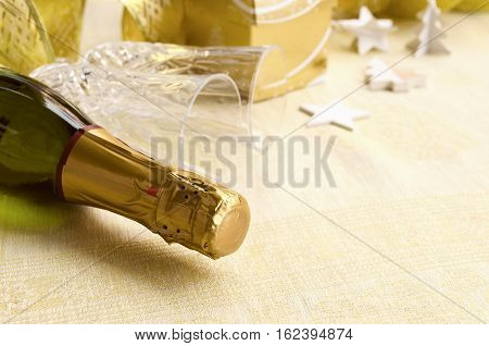 The bottle of champagne with two two elegant flutes and festive decoration. 2017 Happy New Year concept. Copy space