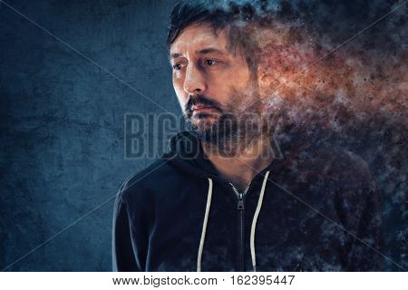 Mental health concept with depressive man dissolving into pieces