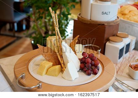 Assorted Cheese platter appetizer on a plate