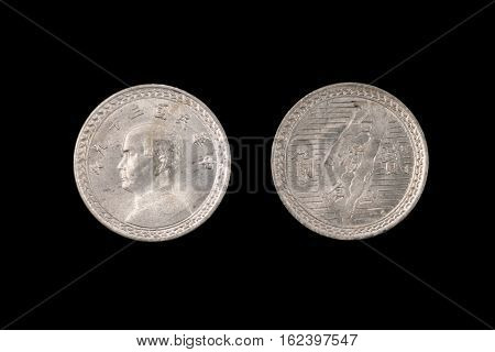 Taiwanese Coin Isolated On A Black Background