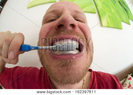 Brushing teeth - close up view. Dental hygiene