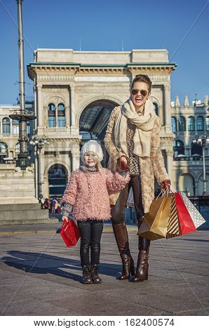Happy Elegant Mother And Daughter Traveller In Milan, Italy