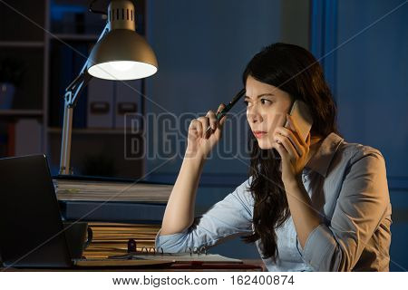 Asian Business Woman Talk On Smartphone Working Overtime