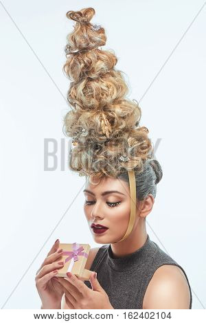 The beautiful woman with Christmas tree hairstyle and snow on eyelashes