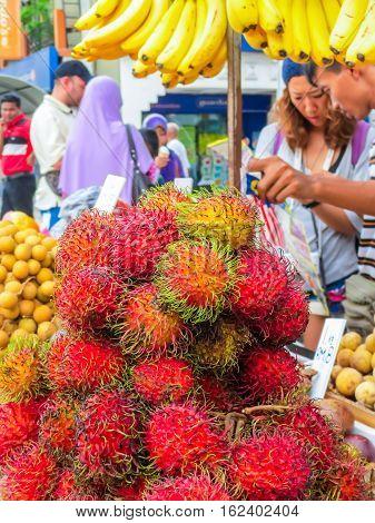 KUALA LUMPUR, MALAYSIA - JANUARY 11, 2014: Exotic fruits on the street market. Chinatown, Kuala Lumpur, Malaysia. Selective focus