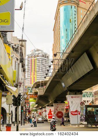 KUALA LUMPUR, MALAYSIA - JANUARY 11, 2014: City traffic in the Chinatown, Kuala Lumpur, Malaysia