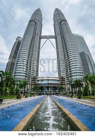 KUALA LUMPUR, MALAYSIA - JANUARY 12, 2014: Petronas Twin Towers and fountain at a main entrance. Kuala Lumpur, Malaysia