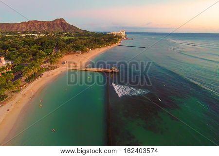 Aerial view of Waikiki Beach and Diamond Head at sunset