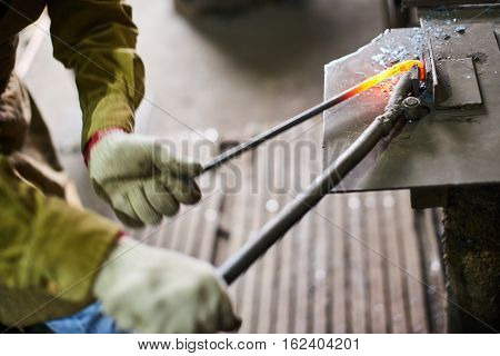 Men's hands in the process of production of metal Handicrafts