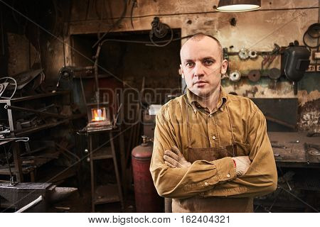Portrait of a forge in the workshop