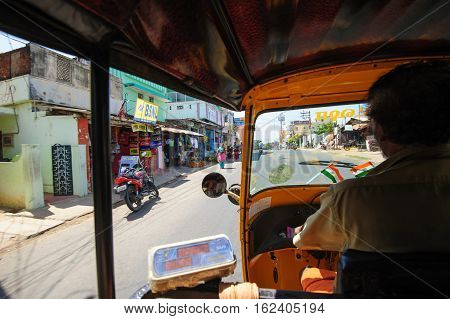 Tuc-tuc driver at work in Kanyakumari, 7 October 2016, Tamil Nadu India