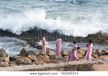 Indian woman on Indian Ocean coast in Kanyakumary, 7 October 2016, Tamil Nadu India