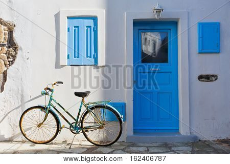 Old bicycle in front of a traditional house in Mandraki village on Nisyros island.