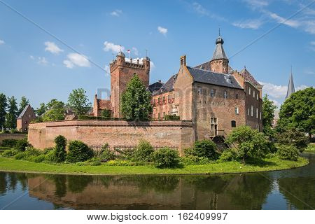 S'HEERENBERG, GELDERLAND/ THE NETHERLANDS - JUNI 4,2016:View of the historical castle Haus Berg in a sunny summer day