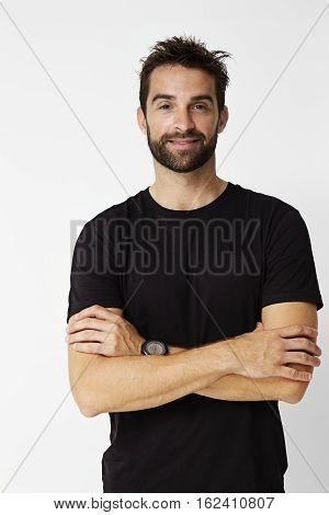 Dude in black t-shirt looking at camera