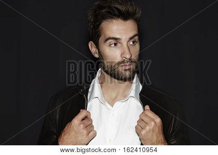 White shirt guy in black studio portrait