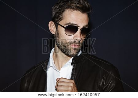 Dude in shades looking away studio shot