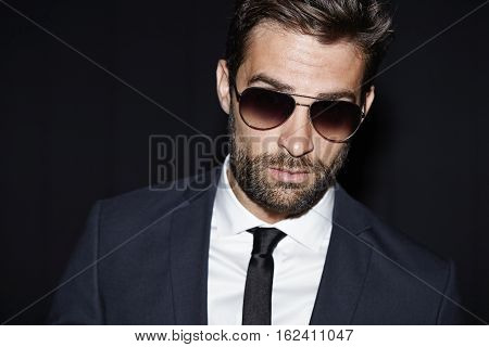 Suave guy in shades and suit portrait