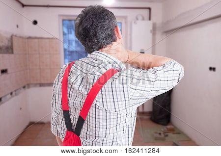 Rear View Of Repairman Or Plumber