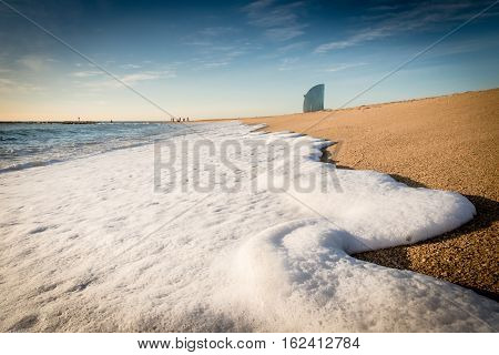 Wave Foam On The Beach